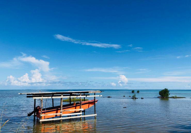 Bâteau, motu et lagon - Raiatea - Polynésie